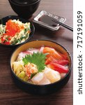 seafood sashimi rice bowl   Shutterstock . vector #717191059