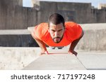 determined sporty man doing... | Shutterstock . vector #717197248