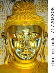 gleaming face of buddha image...   Shutterstock . vector #717206308