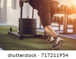 Small photo of sled push man pushing weights workout exercise at gym