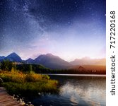 Stock photo fantastic starry sky and the milky way over a lake in the park high tatras shtrbske pleso 717220168