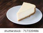 plain cheesecake slice on white ... | Shutterstock . vector #717220486
