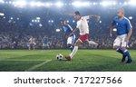 soccer player kicks the ball on ... | Shutterstock . vector #717227566