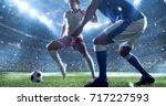 soccer player kicks the ball on ... | Shutterstock . vector #717227593