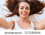 close up portrait of a smiling...   Shutterstock . vector #717235054