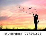 silhouette women and dove birds ...   Shutterstock . vector #717241633