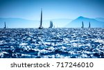 sailboats in the sea  water... | Shutterstock . vector #717246010