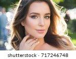outdoors portrait of beautiful...   Shutterstock . vector #717246748