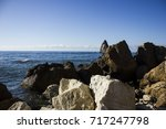 nature rock in the water in the ... | Shutterstock . vector #717247798