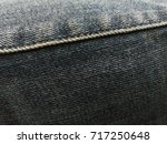 Small photo of JEANS background, denim jeans background with seam of jeans FASHION design. JEAN texture with seams