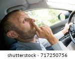 nose picking while driving ... | Shutterstock . vector #717250756
