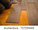 vinyl floor is laid on parquet... | Shutterstock . vector #717254404