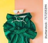 green raincoat and white... | Shutterstock . vector #717255394
