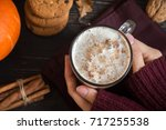 pumpkin spice latte in female... | Shutterstock . vector #717255538