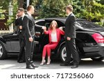 bodyguards helping young... | Shutterstock . vector #717256060
