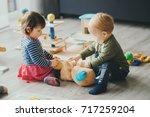 cute little girl and boy... | Shutterstock . vector #717259204