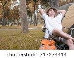 man tourist sitting on chair... | Shutterstock . vector #717274414
