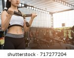 young woman execute exercise... | Shutterstock . vector #717277204