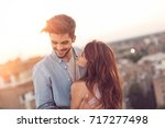 couple in love standing at a... | Shutterstock . vector #717277498