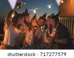 group of young friends having a ... | Shutterstock . vector #717277579