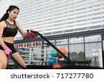 young woman execute exercise in ... | Shutterstock . vector #717277780