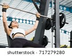 young woman execute exercise... | Shutterstock . vector #717279280