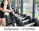 young woman execute exercise in ... | Shutterstock . vector #717279304