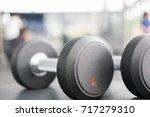 black dumbbell in gym or health ... | Shutterstock . vector #717279310