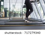 young woman execute exercise in ... | Shutterstock . vector #717279340