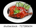 chinese roasted duck cut in... | Shutterstock . vector #717280654