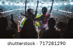 group of fans are cheering for... | Shutterstock . vector #717281290