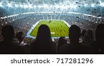 group of fans are cheering for... | Shutterstock . vector #717281296