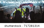 group of fans are cheering for... | Shutterstock . vector #717281314