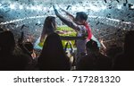 group of fans are cheering for... | Shutterstock . vector #717281320