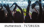 group of fans are cheering for... | Shutterstock . vector #717281326
