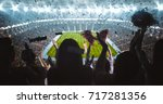 group of fans are cheering for...   Shutterstock . vector #717281356
