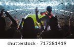 group of fans are cheering for... | Shutterstock . vector #717281419