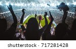 group of fans are cheering for... | Shutterstock . vector #717281428