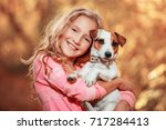 Stock photo child with dog at autumn happy girl with pet 717284413