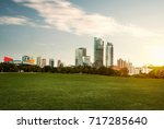 city park under blue sky with... | Shutterstock . vector #717285640