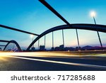 highway bridge at night with... | Shutterstock . vector #717285688