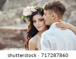portrait of the bride and groom ... | Shutterstock . vector #717287860