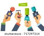 hands hold microphones ...   Shutterstock .eps vector #717297214