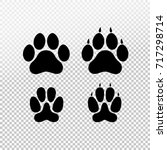Stock vector dog or cat set paw print flat icon for animal apps and websites template for your graphic design 717298714