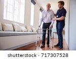 senior woman using a walking... | Shutterstock . vector #717307528