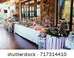 candy bar with pink fancy cakes ... | Shutterstock . vector #717314410