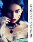 beautiful halloween vampire... | Shutterstock . vector #717315214