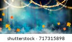 fantasy halloween background.... | Shutterstock . vector #717315898