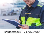 airport technical staff hand... | Shutterstock . vector #717328930