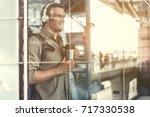 positive traveler male is... | Shutterstock . vector #717330538